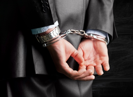business crime: Handcuffs.