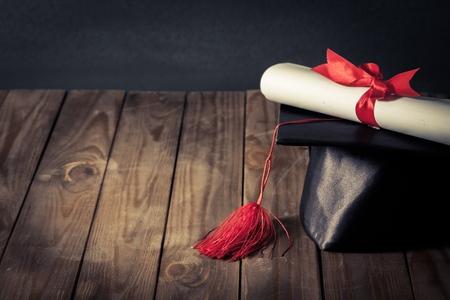 graduation cap and diploma: University. Stock Photo