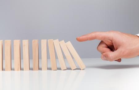 person falling: Domino.