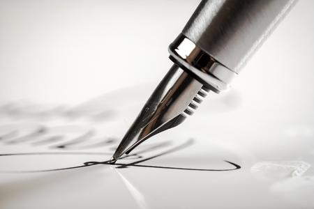 paper and pen: Pen.