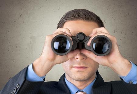 looking through an object: Binoculars. Stock Photo