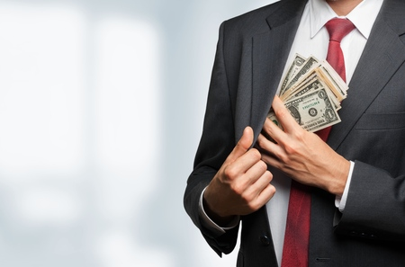 man holding money: Money. Stock Photo