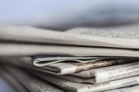newspaper stack: Media.