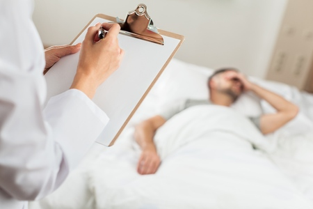 doctor writing: Bed. Stock Photo