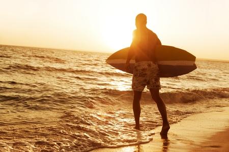 hawaii sunset: Surfing.