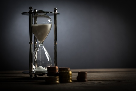 beat the clock: Money. Stock Photo