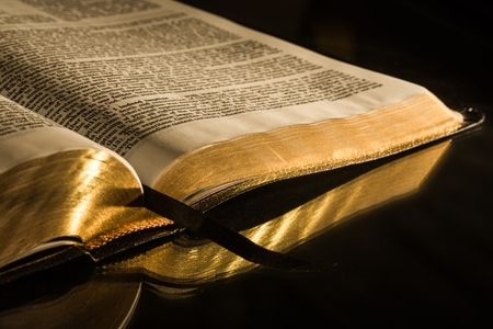 gold cross: Bible. Stock Photo