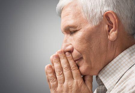 senior adult man: Praying. Stock Photo