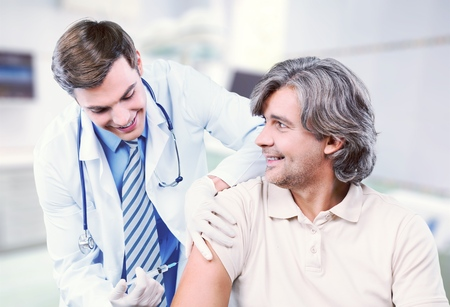injecting: Injecting. Stock Photo