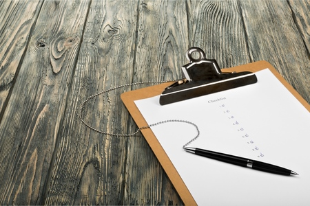 scrutinize: Checklist. Stock Photo