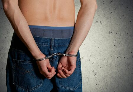 red handed: Handcuffs.