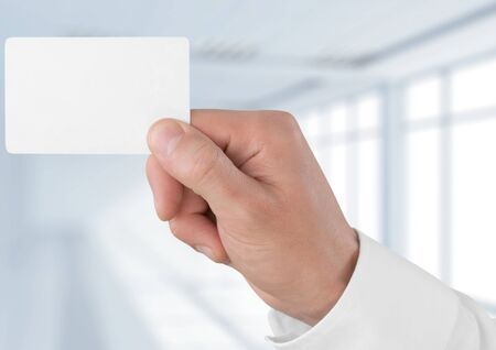 business in hand: Human Hand holding a card