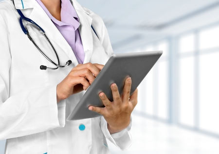 medical career: Doctor holding tablet Stock Photo