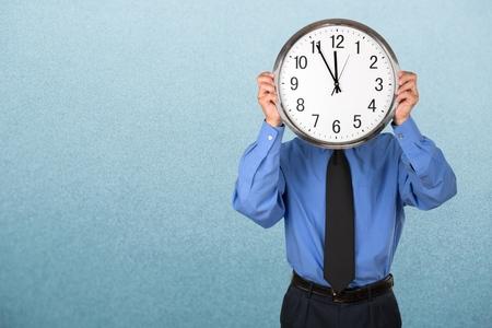 file clerk: Man holding a Clock.