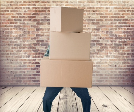 package: Man lifting Package. Stock Photo
