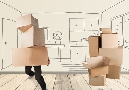 overburdened: Man lifting Boxes of a moving house concept. Stock Photo