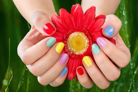nailart: Closeup of a colorful finger nail
