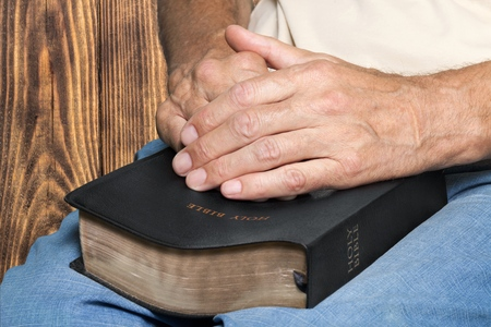 geriatrics: Hand holding Bible. Stock Photo
