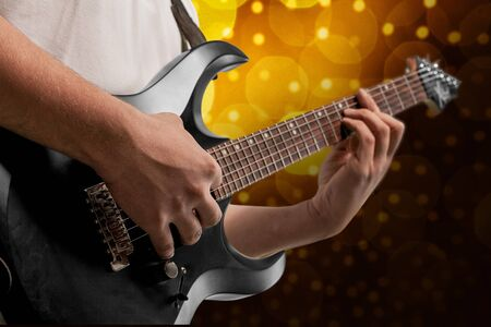 nightclub: Man holding Guitar. Stock Photo
