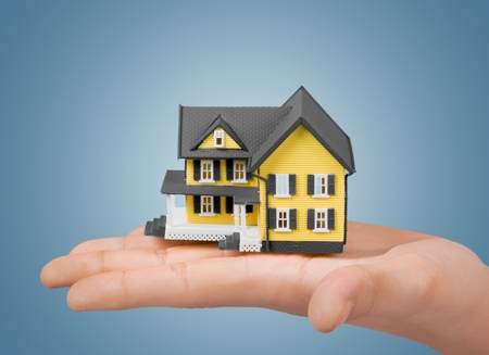 dollhouse: Buying House concept. Stock Photo