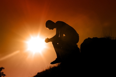 forgiveness: Praying. Stock Photo