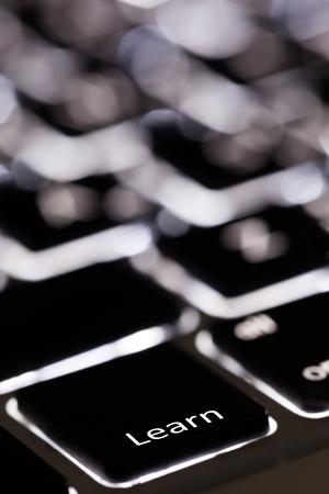backlit keyboard: Learning. Stock Photo