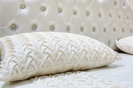 white pillow: Bed. Stock Photo