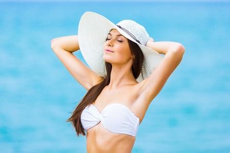 white hat: Beach.