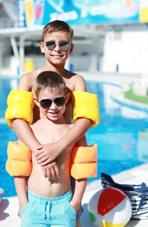 young boy in pool: Swimming. Stock Photo