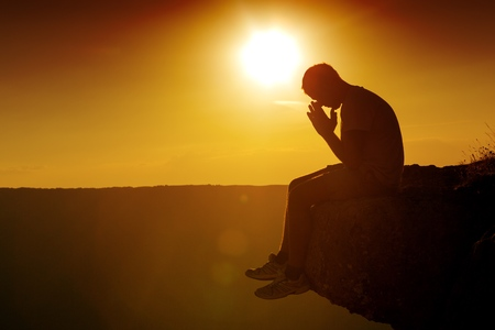 Praying. Foto de archivo