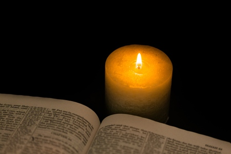 votive candle: Bible. Stock Photo