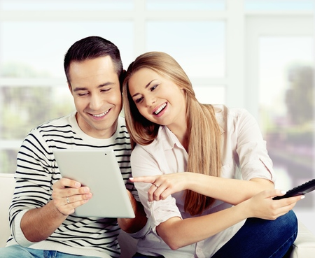 woman watching tv: Tablet. Stock Photo