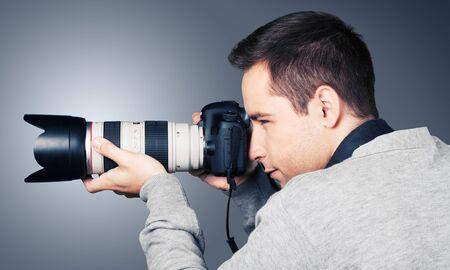 reflex: Photographer.