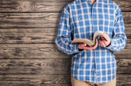 holding bible: Book.