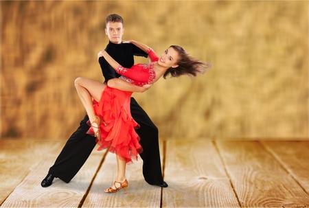 hispanic couple: Dancing.
