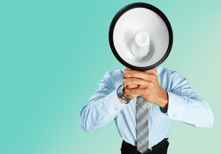 businessman using a megaphone: Megaphone. Stock Photo