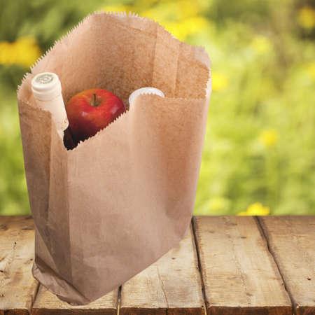 apple paper bag: Groceries.