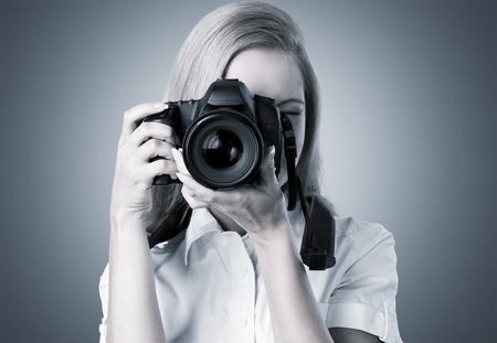 photographic camera: Photographer.