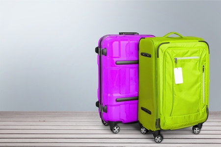four objects: Suitcase.