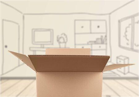 package sending: Cardboard Box. Stock Photo