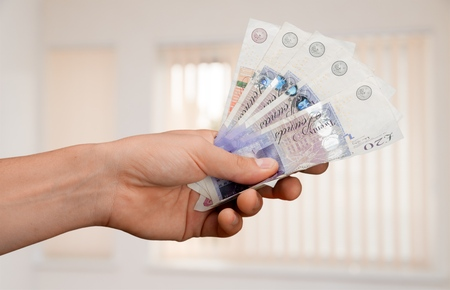 male hand: British Currency. Stock Photo