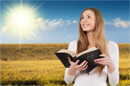 woman looking: Bible. Stock Photo