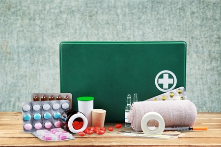 first aid box: First Aid Kit.
