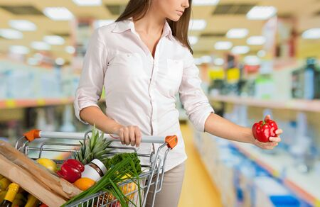 woman shopping cart: Supermarket. Stock Photo