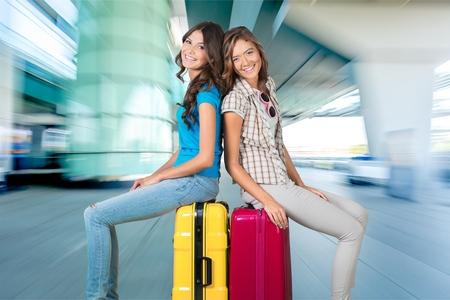 legs crossed on knee: Airport.