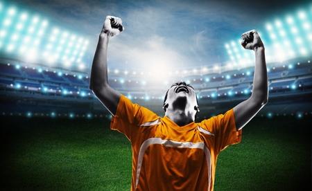 triumphant: Soccer. Stock Photo