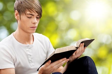 early teens: Man reading bible. Stock Photo