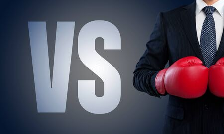 seeker: Man boxer pointing the text: VS.