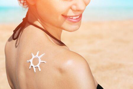 suncare: Sun cream on skin of the woman. Stock Photo