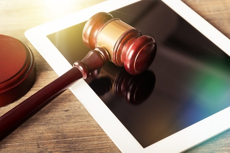 compute: Judge gavel and tablet compute.